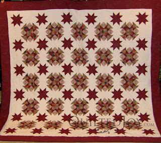 Apple Orchard Quilt with edge to edge quilting by Angela Huffman