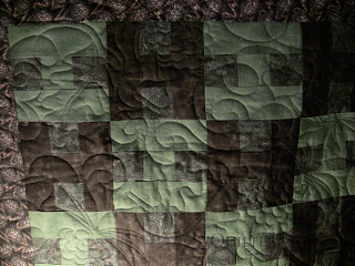 Flannel Pine Cone Quilt with edge to edge quilting by Angela Huffman