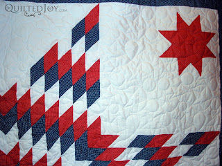Patriotic Lone Star Quilt with stars and loops edge to edge quilting - QuiltedJoy.com