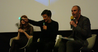 Matt Smith demonstrating his Sonic Screwdriver - note it's green not blue! - on stage with Karen Gillan (Amy Pond) and interviewer Joe Lindsay