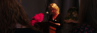 Grainne McCann reading at trans festival Sunday Service