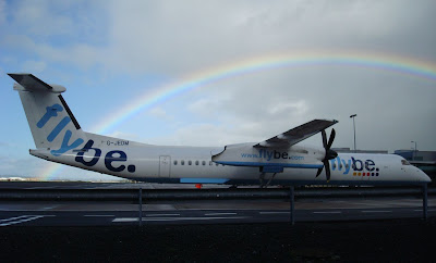 Rainbow behind Flybe plane parked on apron at Belfast City Airport