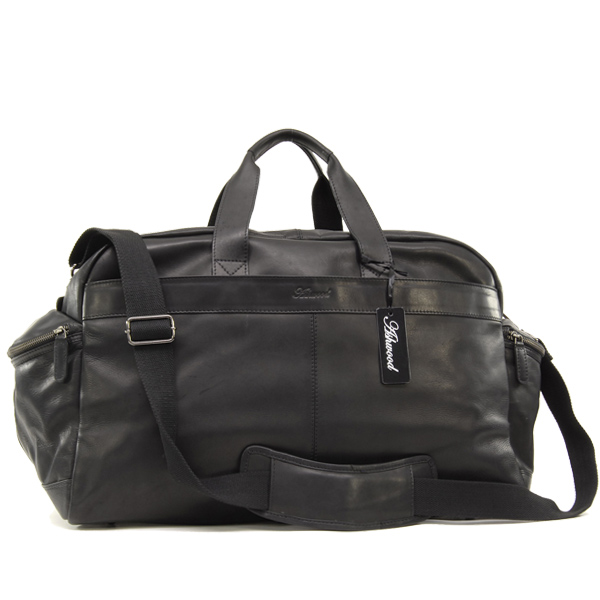 A Simple Yet Stylish Barrel Shaped Weekender Bag By German Company Hugo Boss And Available In Either Black Or Navy Leather Perfect For City Break
