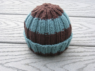 10363324342 Yarn  Baby Cashmerino in 203 and 340 (~1 3 of a skein of each) Needles  US  Size 8s 5.00 mm. Pattern  Ribbed Baby Hat by Lucy