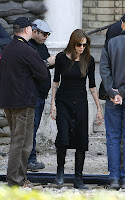 Angelina Jolie kissing Brad Pitt and working on her movie in Budapest