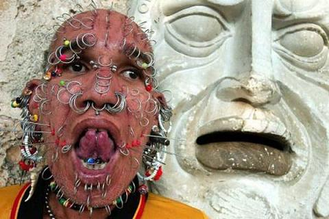 Strange Man with 300 Holes in his Face Seen On www.coolpicturegallery.net