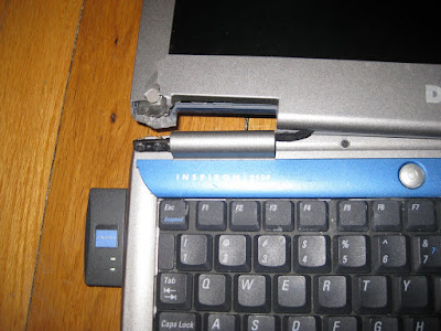 Close up photo of laptop's broken hinge
