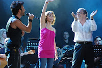Tarkan and Sertab Erener on stage with Fahir Atakoğlu at the Harbiye