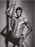 Sport celebrity David Beckham hangs on a large rope in his Armani briefs in his latest Emporio Armani underwear campaign © Alas/Piggott