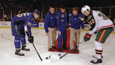 Astronauts Dropping the Puck