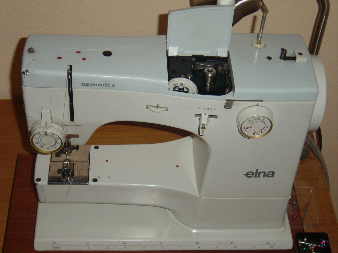 OK, so I would never pay $5K for a sewing machine anyway, but don't tell  Mabel! She has lots of good points!