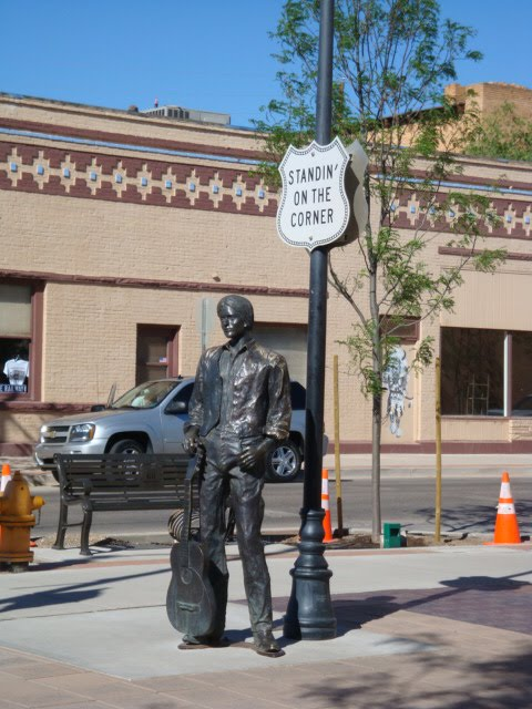top of the arch standing on the corner in winslow arizona. Black Bedroom Furniture Sets. Home Design Ideas