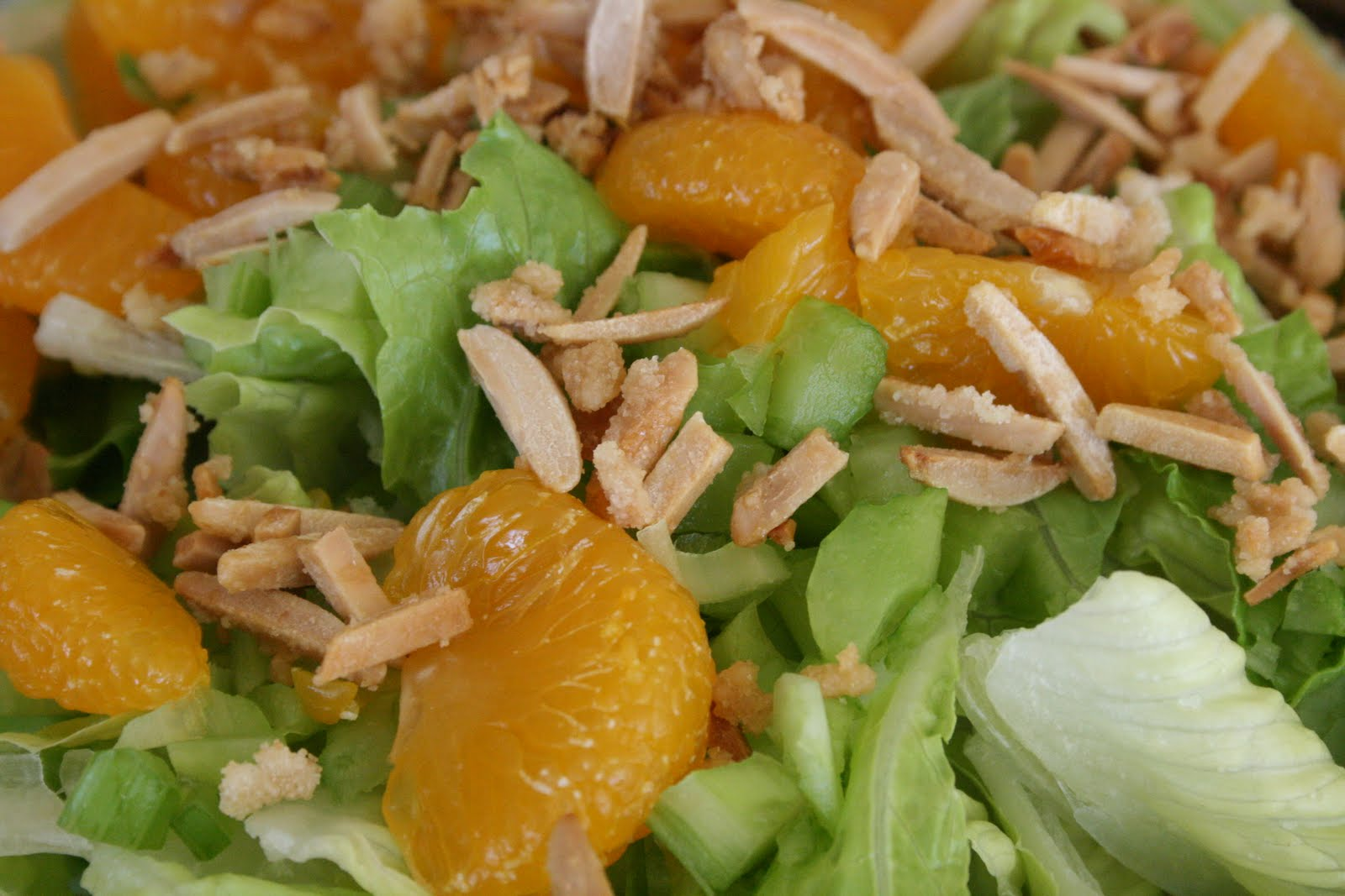 Crisp romaine crumbled bacon mandarin orange segments toasted almonds and a homemade vinaigrette make this green salad a standout