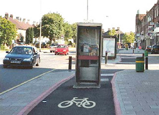 phone box in cycle path
