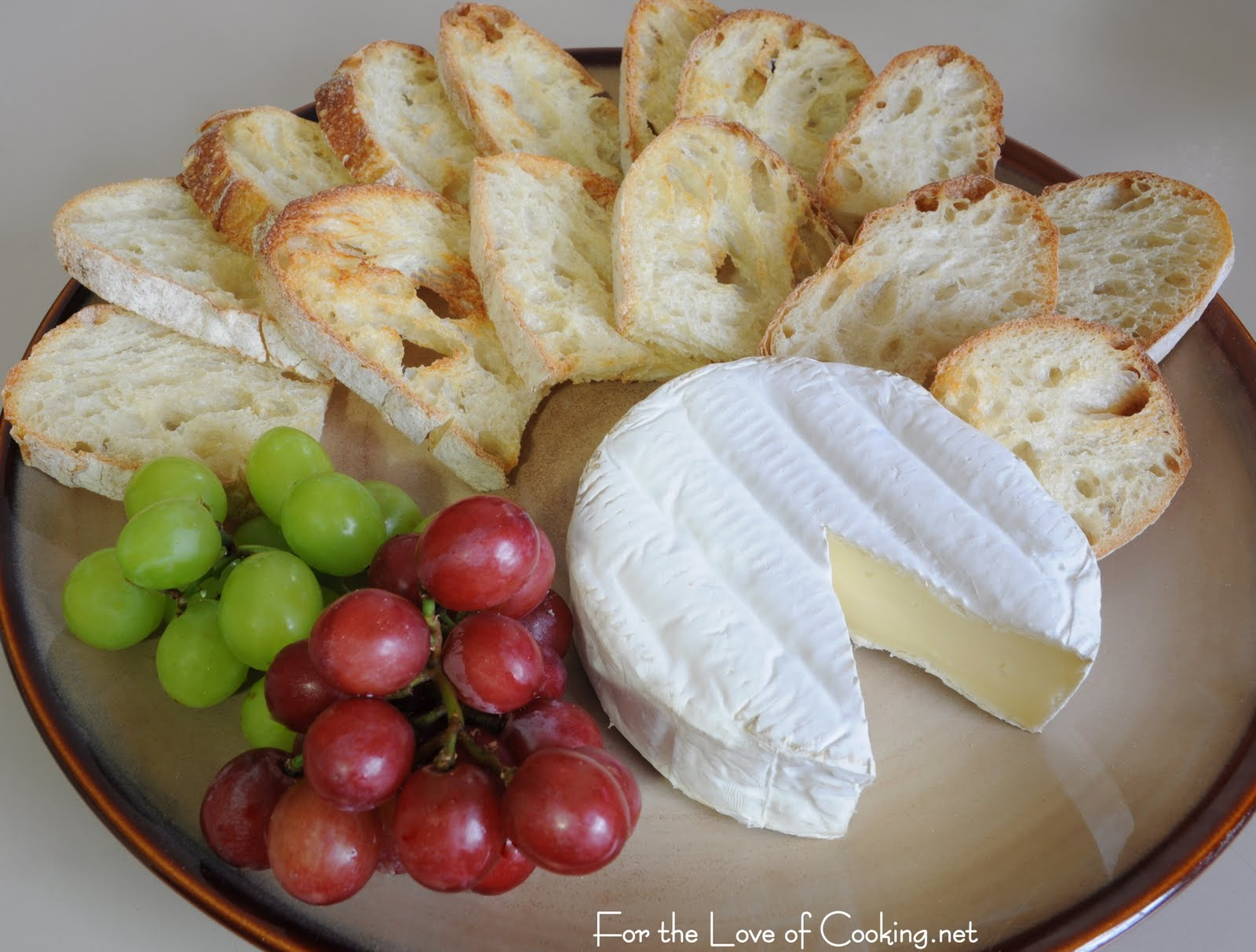 Brie Served With Crostini And Grapes For The Love Of Cooking