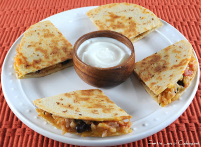 Mexican Tomato Rice and Bean Quesadilla with Sharp Cheddar and Sour Cream