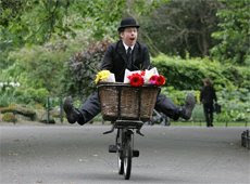 Leopold Bloom flying through St. Stephen's Green on his bike