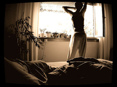 girl stretching in bedroom morning