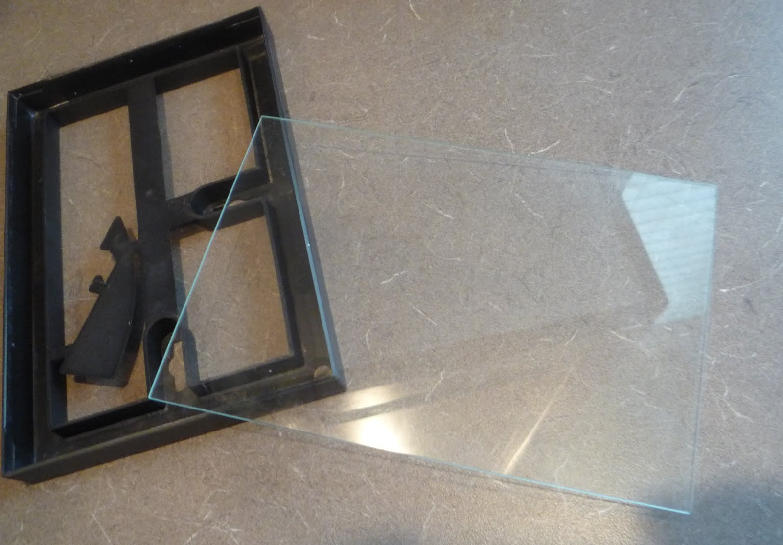 c6de5f6840a Carefully pop the glass out of the second photo frame and place into hinged  frames along with print cut to size.