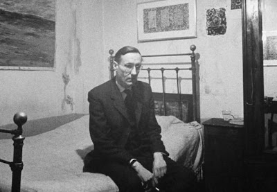 Author William Burroughs, an ex-dope addict, relaxing on a shabby bed in what is known as a Beat Hotel. Paris, 1959. Photograph: Life/ Loomis Dean.