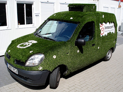 Car Covered In Grass