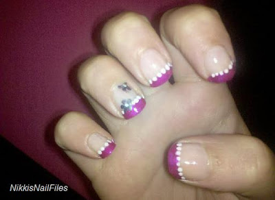 fuschia manicure; pink nails with white flowers;