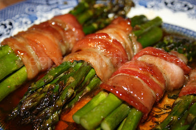 Fresh asparagus spears, wrapped in bacon and cooked in a spicy brown sugar butter sauce.