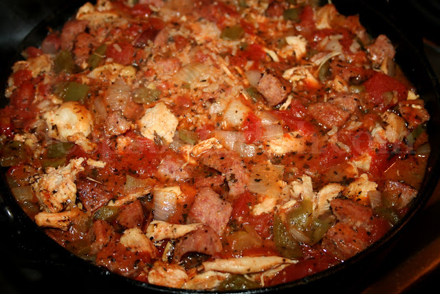An oven baked Creole jambalaya containing chicken, shrimp and andouille smoked sausage.