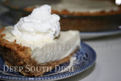 A Key lime pie made with cream cheese, sweetened condensed milk and Key lime juice in a coconut graham cracker crust and served with minty whipped cream.