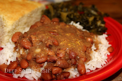 Pinto beans, slow cooked with ham, onion, celery and jalapenos, served over rice with a side of collard greens and hoecakes. Now that is some good eatin'!