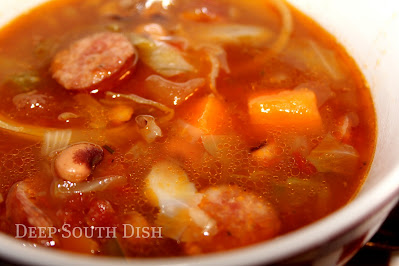 A beef broth and tomato based soup made with smoked sausage, sweet potatoes, black-eyed peas and cabbage.