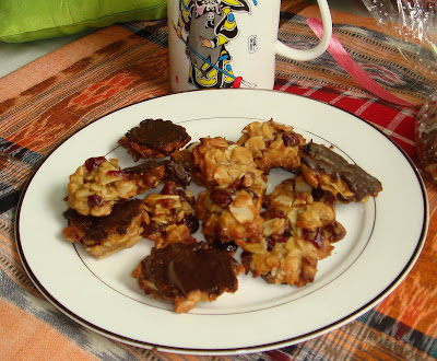 Almond Florentine an crunchy eggless recipe made in minutes,that melts in your mouth and the chocolate coating with the underneath  is heavenly.