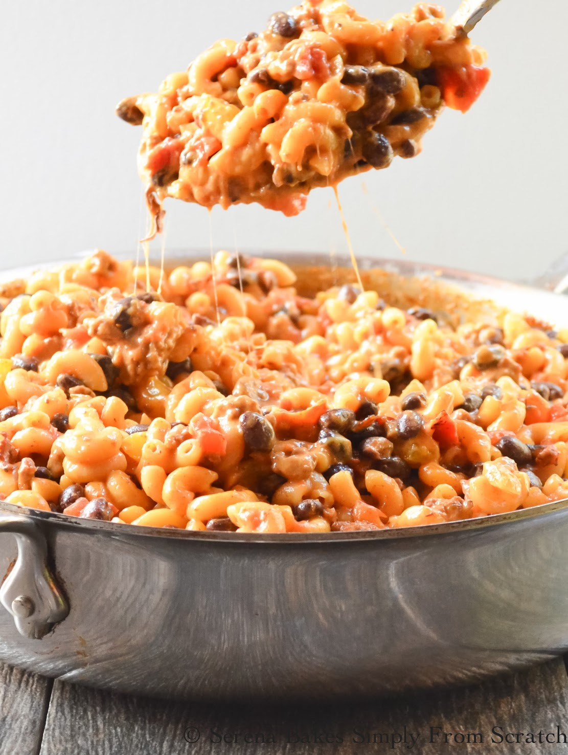 One Pot Chili Mac And Cheese is a combination of two family favorites from scratch and as easy to make as Hamburger Helper. Done in under 30 minutes. www.serenabakessimplyfromscratch.com