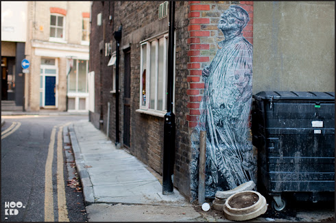 Beautiful large scale pasteup street art in Shoreditch by artist Swoon