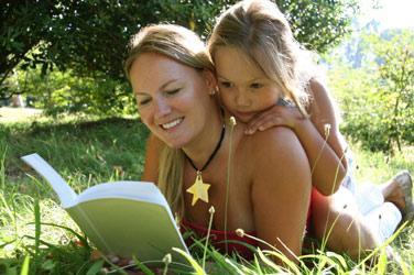 mom_reading_grass_full.jpeg