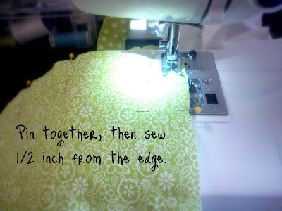 A sewing machine sewing fabric with instruction on how to sew it.