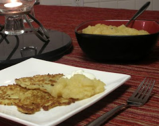 Delicious potato latkes, traditional for Hanukkah, celebrated here, yes, with the lighting of the Advent candle