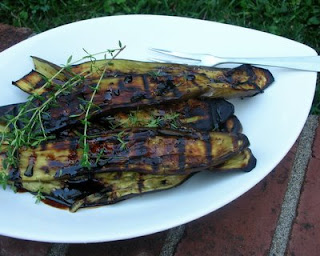 Simple grilled eggplant topped with fresh thyme and drizzled with a balsamic & honey syrup