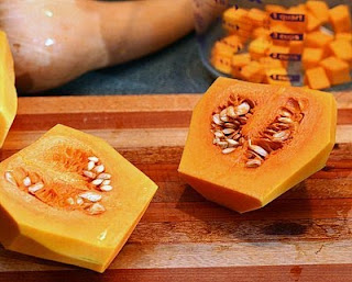 Cut the bulb in half (How to Safely Cut a Butternut Squash into Pretty Little Cubes, Step by Step ♥ AVeggieVenture.com)