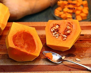 Scoop out the seeds and gunk (How to Safely Cut a Butternut Squash into Pretty Little Cubes, Step by Step ♥ AVeggieVenture.com)