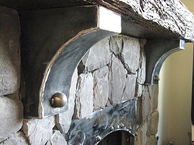 metal corbels on a rock fireplace