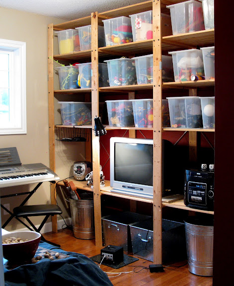 Toy storage in floor to ceiling Ikea bins and Gorm shelving in a kid's playroom | funkyjunkinteriors.net