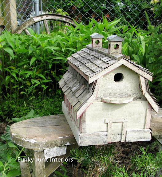 barn birdhouse on a wooden garden bench / FunkyJunkInteriors.net