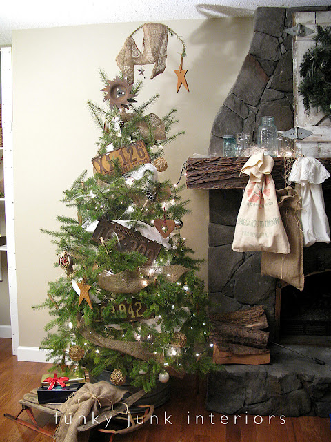 The Whoville Christmas tree with a top droop with rusty junk ornaments and a metal tub for a tree skirt