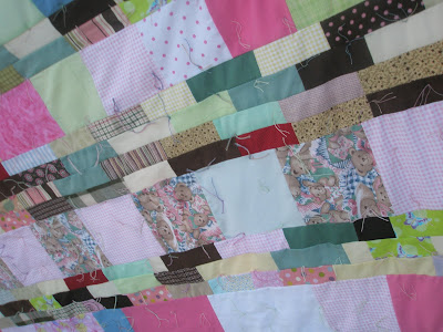Humanitarian scrappy strip quilt twin size with sheet for backing