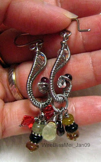 seahorse tail earrings