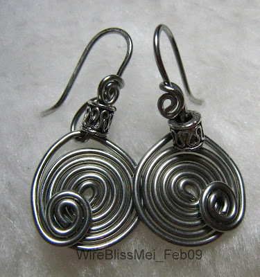simple pair of spiral earrings with 17ga stainless steel wire