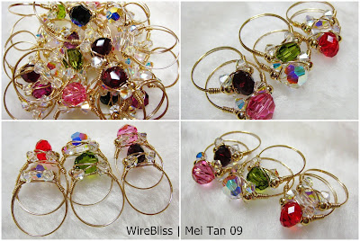 a bunch of wire wrapped sparkly crystal rings - swarovski crystal