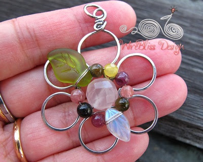 Holding the multi gemstones Wire Wrapped Floral Pendant