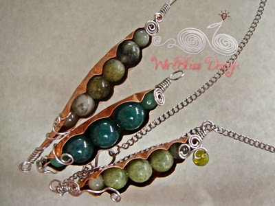 three pieces of wire wrapped Peas in a Pod pendant with copper sheet and gemstones